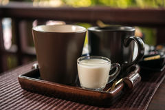 Cup of tea with milk at the wooden table, breakfast Royalty Free Stock Images
