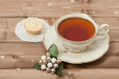 Cup Of Tea. Mince Pie. Shining Stars. Wooden Royalty Free Stock Images