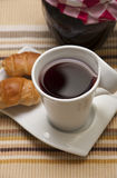 Cup of tea, mini croissants and jam. Jar Royalty Free Stock Photos