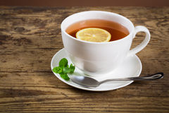 Cup of tea with mint leaf and lemon Royalty Free Stock Photos