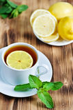 Cup of tea with mint and lemon Royalty Free Stock Photo