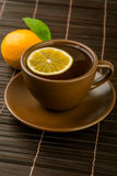 Cup of tea with mint and lemon Stock Images