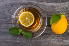 Cup of tea with mint and lemon Royalty Free Stock Images