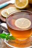 Cup of tea with mint and lemon Stock Photos