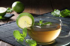 Cup of tea with mint and lime Royalty Free Stock Image