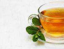 Cup of tea with  mint. On a old white wooden background Stock Image