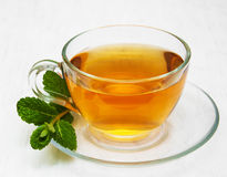 Cup of tea with  mint. On a old white wooden background Stock Photos