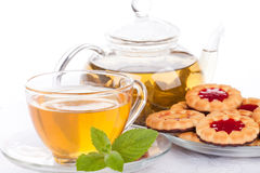 Cup of tea  with mint and pastries. Stock Image