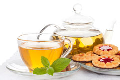 Cup of tea  with mint and pastries. Royalty Free Stock Images