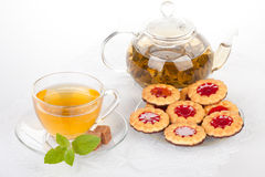 Cup of tea  with mint and pastries. Stock Photos