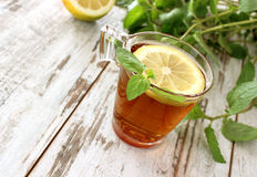 Cup of tea with mint on  wooden boards Stock Photos