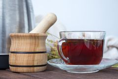 Cup of tea with a mortar and pestle Stock Photos