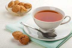 Cup of tea and muffins Stock Images