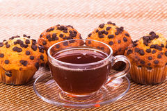 Cup of tea and muffins. Deserts Royalty Free Stock Photography