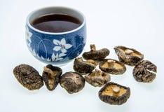 Cup of tea and mushroom varieties Stock Photos