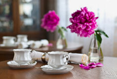 A cup of tea and napkin and peony Royalty Free Stock Photography