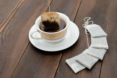 Cup of tea and new teabags Stock Images