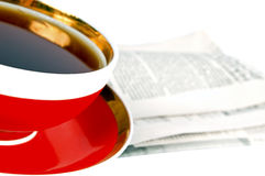 A cup of tea and a newspaper. Isolated on white Stock Image