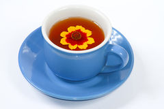 The cup of tea with nice flowers. The blue cup of tea with nice flowers Royalty Free Stock Photography