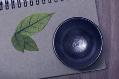 Cup of tea on notebook.Top view with copy space royalty free stock photo