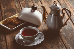 Cup of tea. O old wood board with some cookies and teapot Royalty Free Stock Image
