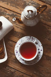 Cup of tea. O old wood board with some cookies and teapot Stock Image
