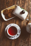 Cup of tea. O old wood board with some cookies and teapot Royalty Free Stock Photo