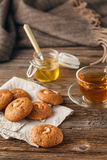Cup of tea with oatmeal cookie on dark wooden table covert table Stock Images