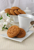 A cup of tea with oatmeal cookies Stock Photo