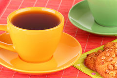 A cup of tea and oatmeal cookies Royalty Free Stock Image