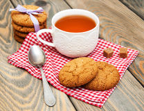 Cup of tea with oatmeal cookies Stock Image