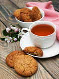 Cup of tea with oatmeal cookies Royalty Free Stock Photo