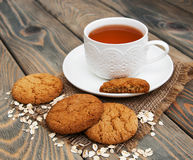 Cup of tea with oatmeal cookies Stock Images