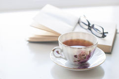Cup of tea, old book and glasses Royalty Free Stock Image