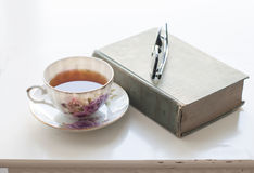 Cup of tea, old book and glasses Royalty Free Stock Photography