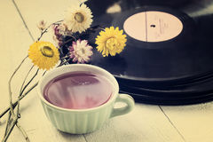 Cup of tea, old vinyl records and dry flowers Royalty Free Stock Images