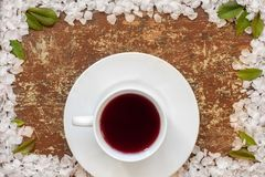 Cup of tea on old wooden table stock images