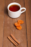 Cup of tea on an old wooden table. small depth of field Stock Photo