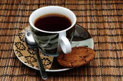 Cup of tea and one cookie Royalty Free Stock Photography