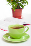 Cup of tea, open book and indoor plant. Concept of reading, stud Royalty Free Stock Image