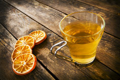 Cup of tea and orange circles. Royalty Free Stock Image