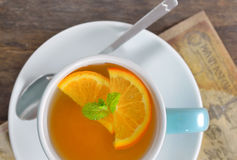 Cup of tea and orange slices Stock Images
