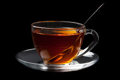 Cup of tea over black background Stock Image