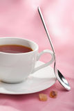 Cup of tea over pink Royalty Free Stock Images