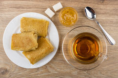 Cup of tea, pancakes with stuffed, lemon jam, sugar Royalty Free Stock Photography