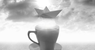 Cup of tea with paper boat and clouds. Digital composite of Cup of tea with paper boat and clouds Stock Images