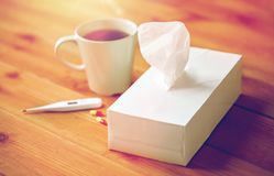 Cup of tea, paper wipes and thermometer with pills Stock Images