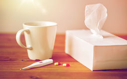 Cup of tea, paper wipes and thermometer with pills Royalty Free Stock Photos