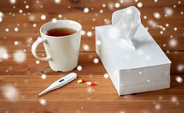 Cup of tea, paper wipes and thermometer with pills Royalty Free Stock Photography