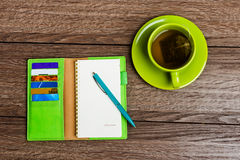 Cup of tea, pen, opened organizer Stock Photography